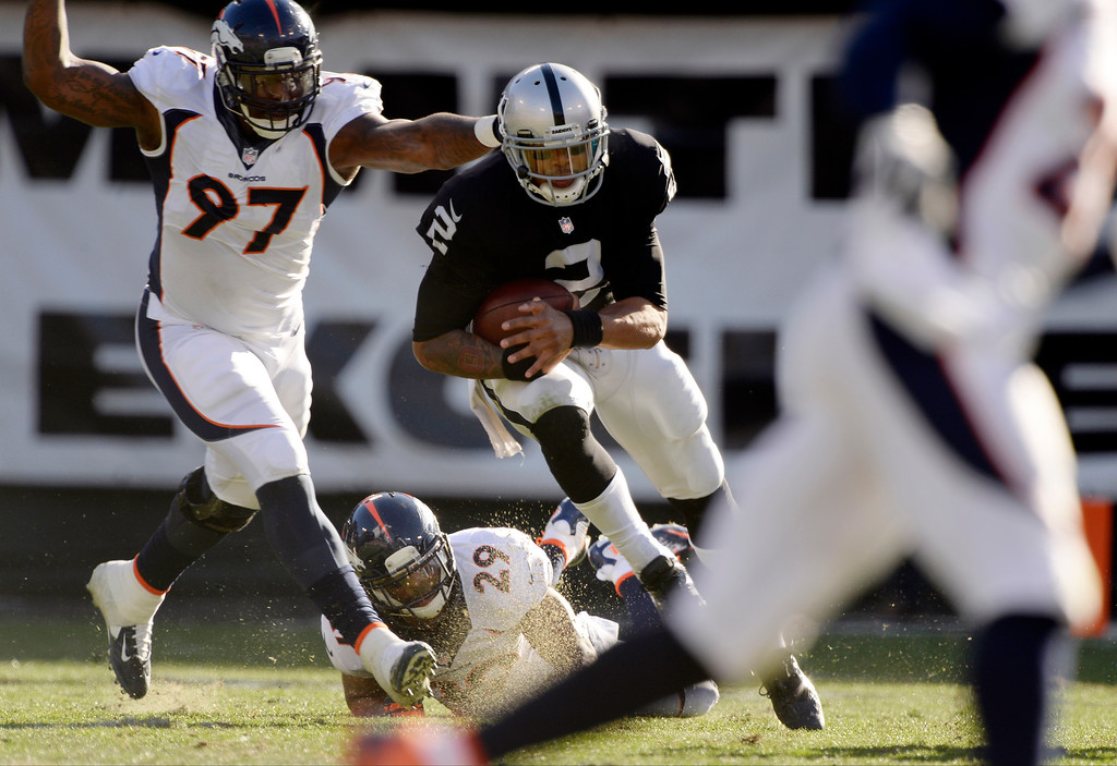 . Denver Broncos defensive end Malik Jackson (97) chases down Oakland Raiders quarterback Terrelle Pryor (2) after a run during the second quarter at O.co Coliseum. (Photo by John Leyba/The Denver Post)