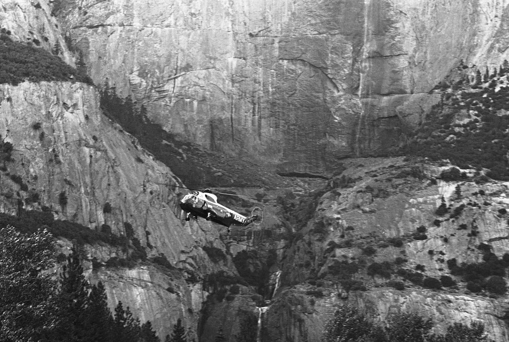. President John Kennedy\'s helicopter is dwarfed by the granite immensity of the face of Yosemite Falls, California on August 17, 1962. Upper Yosemite falls is at upper right and lower Yosemite Falls is below helicopter. The President was in Yosemite for an overnight stay before proceeding to Los Angeles, Calif., and ground breaking ceremonies for the San Luis Dam project tomorrow. (AP Photo)