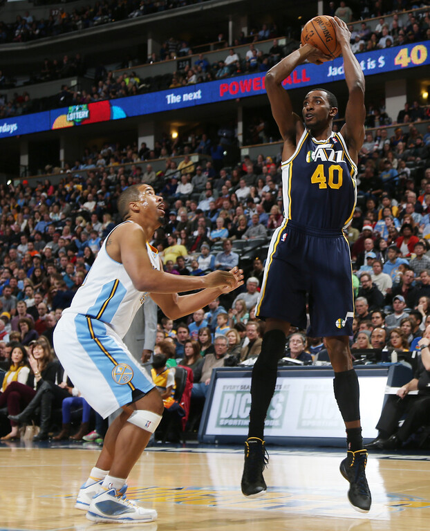 . Utah Jazz forward Jeremy Evans, right, goes up for shot over Denver Nuggets guard Andre Miller in the fourth quarter of Utah\'s 103-93 victory in an NBA basketball game in Denver on Friday, Dec. 13, 2013. (AP Photo/David Zalubowski)