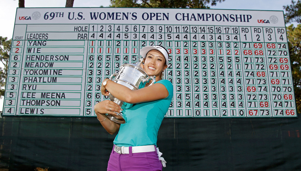 . Michelle Wie poses with the trophy after winning the U.S. Women\'s Open golf tournament in Pinehurst, N.C., Sunday, June 22, 2014. (AP Photo/Bob Leverone)