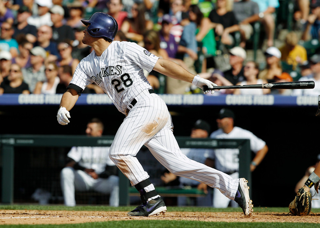 . Colorado Rockies\' Nolan Arenado follows the flight of his RBI-double to drive in the go-ahead run against the Pittsburgh Pirates in the seventh inning of the Rockies\' 3-2 victory in a baseball game in Denver, Sunday, Aug. 11, 2013. (AP Photo/David Zalubowski)