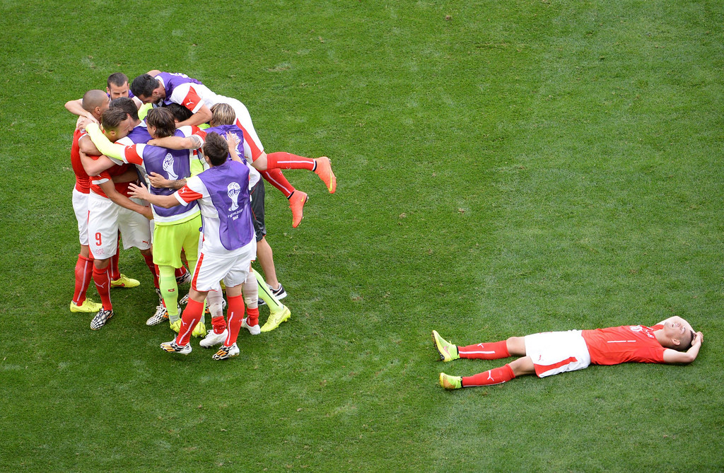 . Switzerland\'s forward Haris Seferovic (2nd L) celebrates scoring with his teammates during a Group E football match between Switzerland and Ecuador at the Mane Garrincha National Stadium in Brasilia during the 2014 FIFA World Cup on June 15, 2014. AFP PHOTO / EVARISTO SA