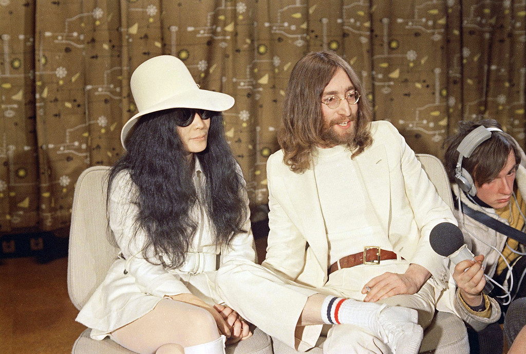 . John Lennon, right, is seen with his wife Yoko Ono at a press conference in 1969.  (AP Photo)