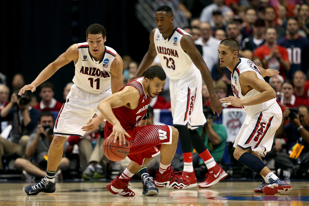 . Traevon Jackson #12 of the Wisconsin Badgers with the ball against Aaron Gordon #11, Rondae Hollis-Jefferson #23 and Nick Johnson #13 of the Arizona Wildcats in the second half during the West Regional Final of the 2014 NCAA Men\'s Basketball Tournament at the Honda Center on March 29, 2014 in Anaheim, California.  (Photo by Jeff Gross/Getty Images)