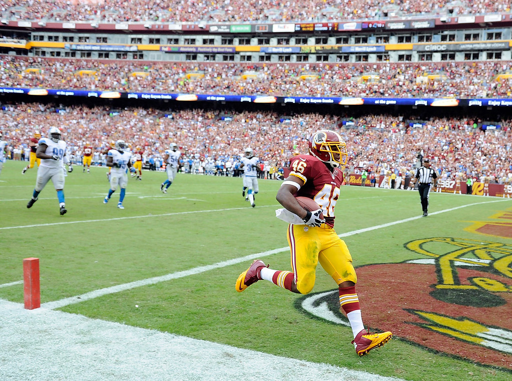 . Alfred Morris #46 of the Washington Redskins scores a touchdown in the second quarter against the Detroit Lions at FedExField on September 22, 2013 in Landover, Maryland.  (Photo by Greg Fiume/Getty Images)