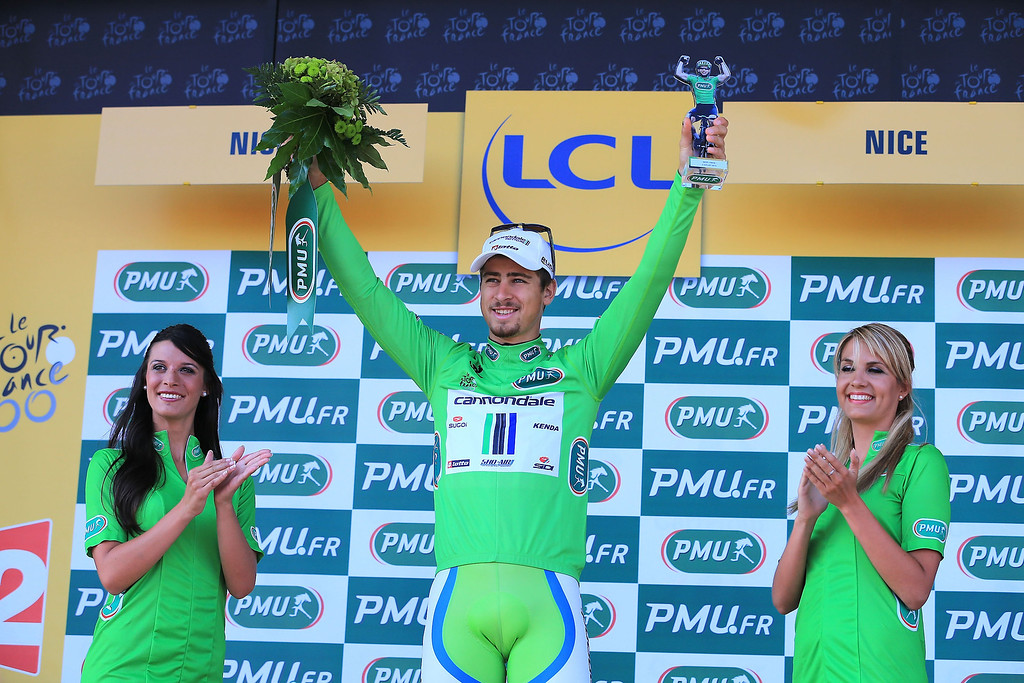 . Peter Sagan of Slovakia and Team Cannondale celebrates his green jersey for best sprinter on the podium after stage four of the 2013 Tour de France, a 25KM Team Time Trial on July 2, 2013 in Nice, France.  (Photo by Doug Pensinger/Getty Images)