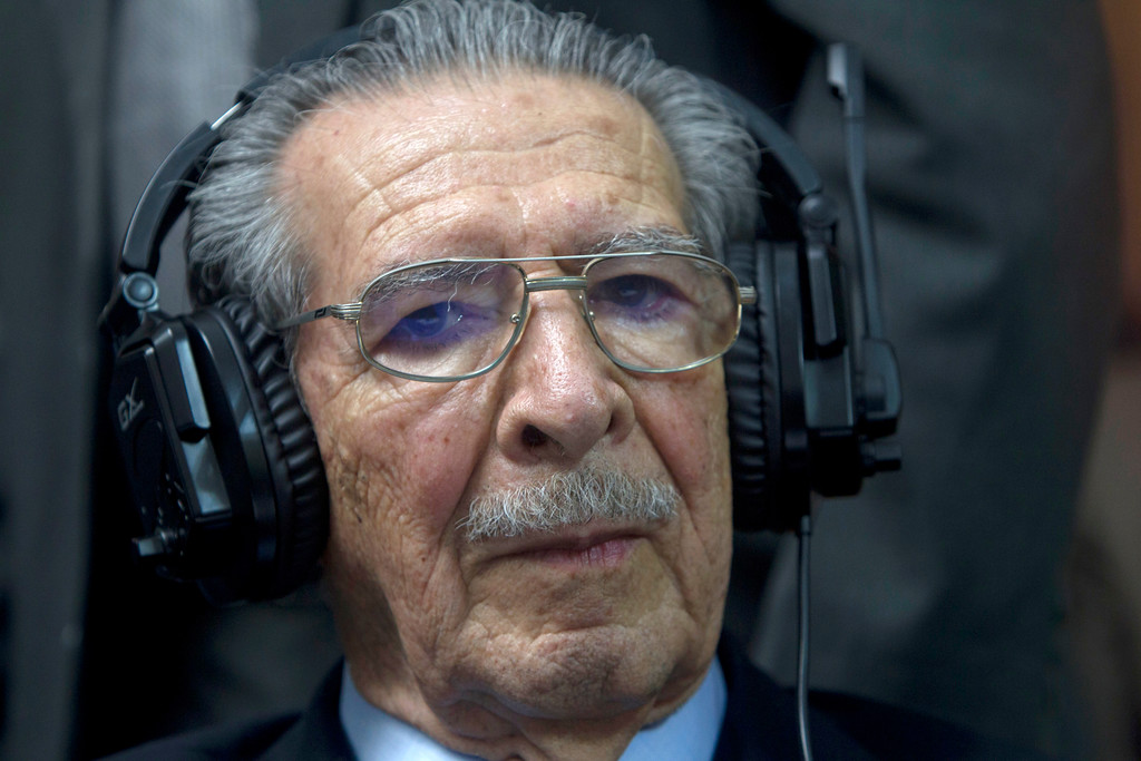. Guatemala\'s former dictator Jose Efrain Rios Montt wears headphones as he listens to the verdict in his genocide trial in Guatemala City, Friday, May 10, 2013. The Guatemalan court convicted Rios Montt on charges of genocide and crimes against humanity, sentencing him to 80 years in prison. The 86-year-old former general is the first former Latin American leader ever found guilty of such a charge. The war between the government and leftist rebels cost more than 200,000 lives and ended in peace accords in 1996. (AP Photo/Moises Castilo)