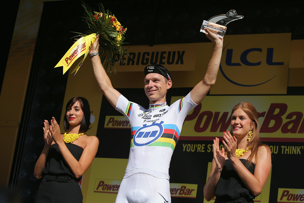 . Tony Martin of Germany and the Omega Pharma - Quick-Step Cycling Team celebrates on the podium after winning the individual time trial during the twentieth stage of the 2014 Tour de France, a 54km individual time trial stage between Bergerac and Perigueux, on July 26, 2014 in Perigueux, France.  (Photo by Doug Pensinger/Getty Images)