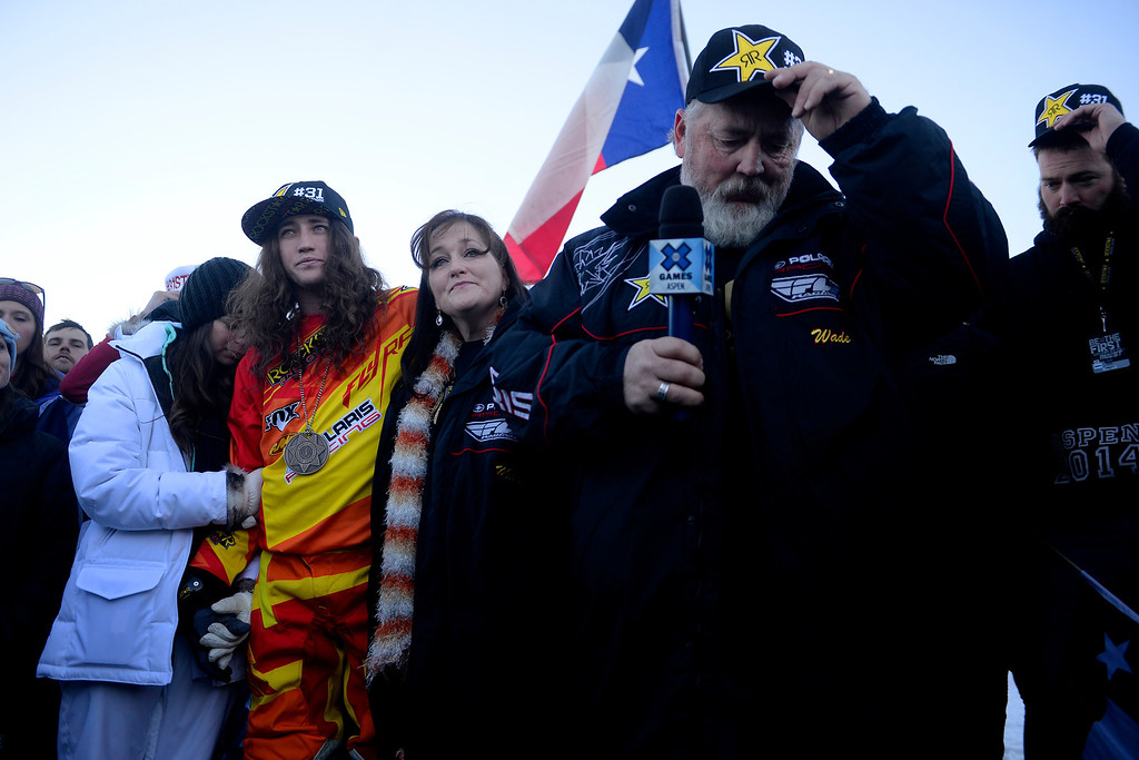 . ASPEN, CO - JANUARY 25: Colten Moore (in racing gear) stands with his girlfriend, Ashley Hammons, his mother, Michelle, and father, Wade, during a celebration of his late brother, Caleb, who was killed in the snowmobile freestyle event at the 2013 X Games Aspen. X Games Aspen at Buttermilk on Friday, January 25, 2014. (Photo by AAron Ontiveroz/The Denver Post)