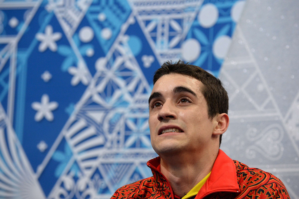 . Spain\'s Javier Fernandez grimaces in the kiss and cry zone during the Men\'s Figure Skating Short Program at the Iceberg Skating Palace during the Sochi Winter Olympics on February 13, 2014.  YURI KADOBNOV/AFP/Getty Images