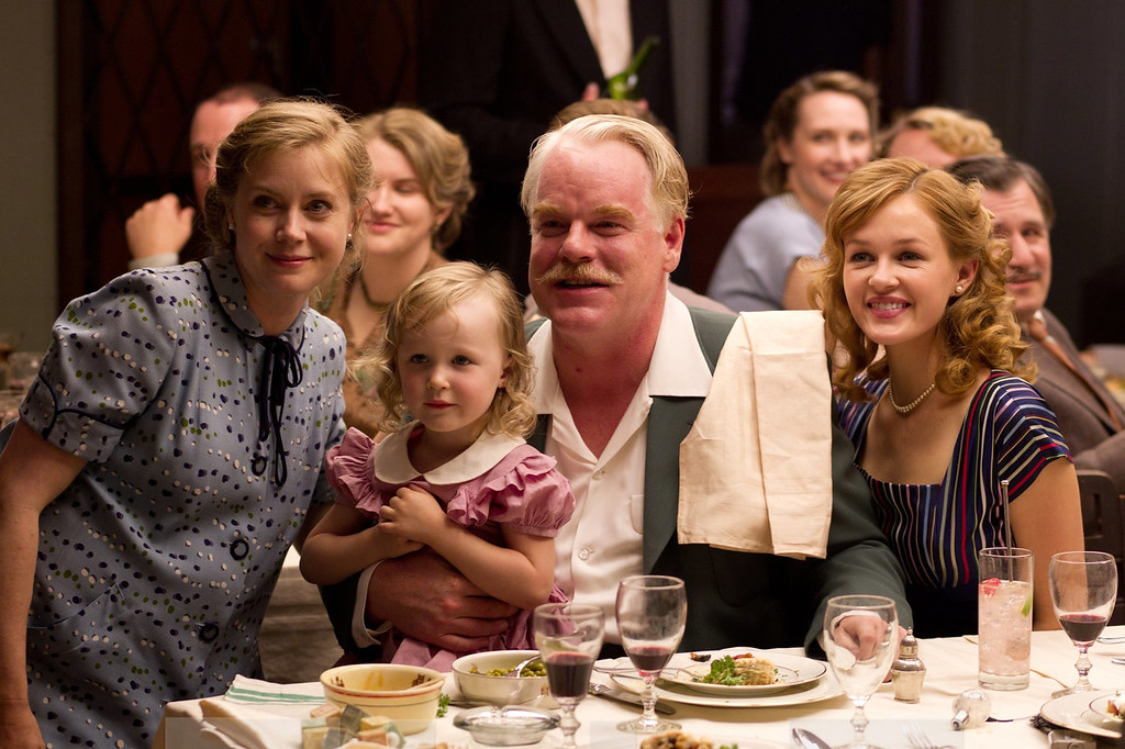 ". Lancaster Dodd (Philip Seymour Hoffman) with his family and followers in Paul Thomas Anderson\'s American epic set in 1950 ""The Master.\"" Courtesy the Weinstein Company."