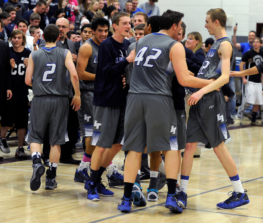. LITTLETON, CO. - MARCH 6: Legend players celebrated the win Wednesday night. The Legend High School boy\'s basketball team upset Chatfield 51-49  in a playoff game Wednesday night, March 6, 2013. (Photo By Karl Gehring/The Denver Post)