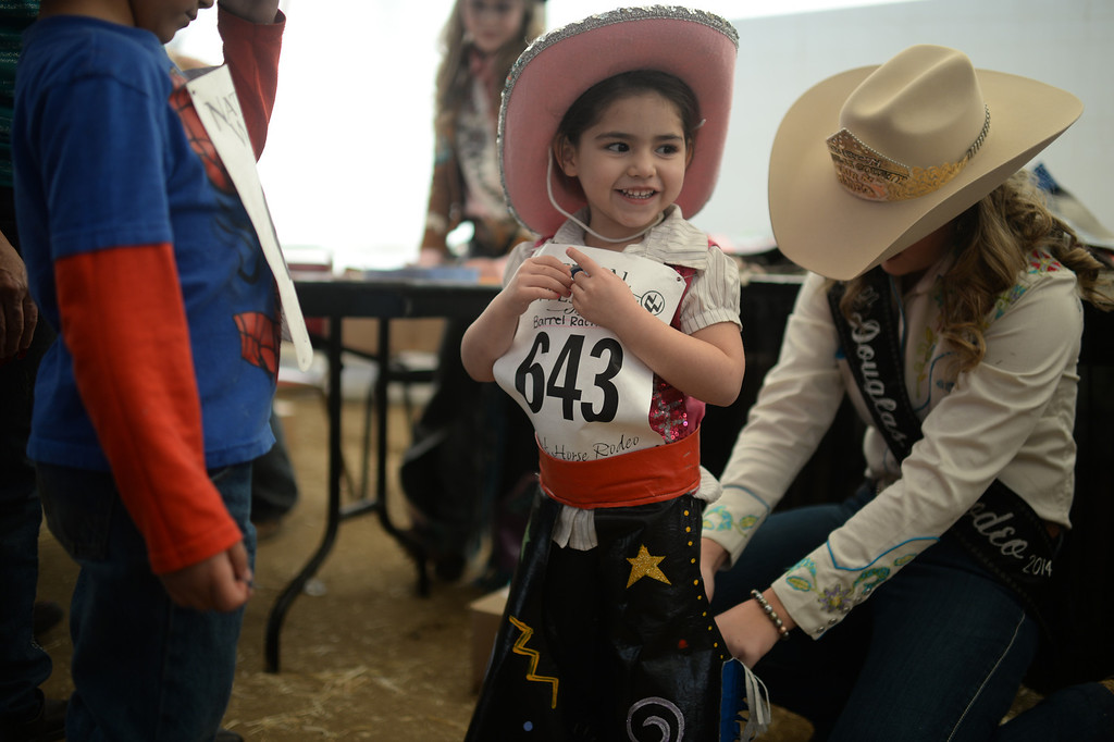 . DENVER, CO. JANUARY 25: Zamara Roybal, 3, gets ready for the stick horse rodeo at Ames Activity Pavilion at the National Western Stock Show in Denver, Colorado January 25, 2014. Twenty-eight children competed in the event. (Photo by Hyoung Chang/The Denver Post)