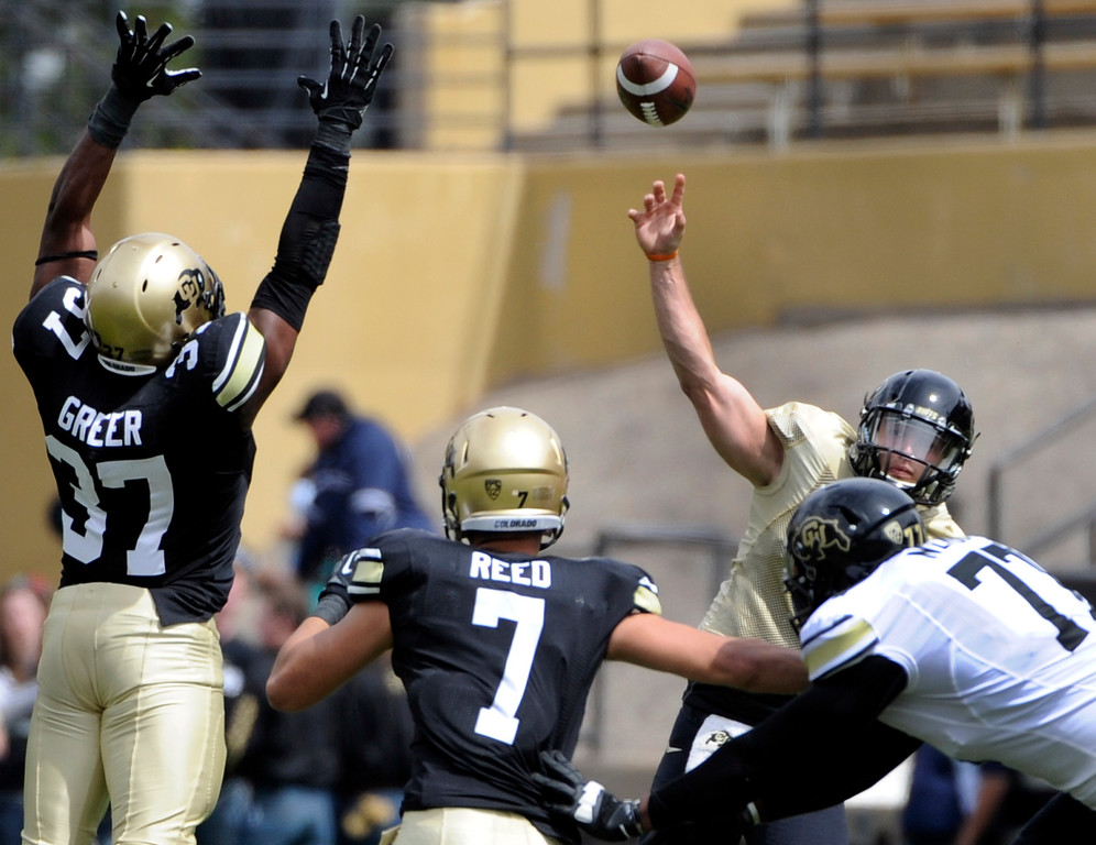 . BOULDER, CO.- APRIL13: White QB Nick Hirschman goes back for a pass. The University of Colorado football team hosts its spring football game at Folsom Field under the direction of new head coach Mike MacIntyre. (Photo By Kathryn Scott Osler/The Denver Post)