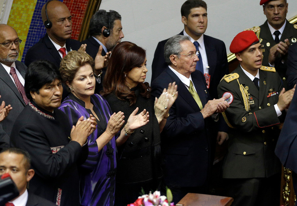. Bolivia\'s President Evo Morales, front row, from left to right, Brazil\'s President Dilma Rousseff, Argentina\'s President Cristina Fernandez and Cuba\'s President Raul Castro applaud during the swearing-in ceremony of President-elect Nicolas Maduro at the National Assembly in Caracas, Venezuela, Friday, April 19, 2013. Haiti\'s President Michel Martelly is pictured in the back row, second from left. (AP Photo/Fernando Llano)