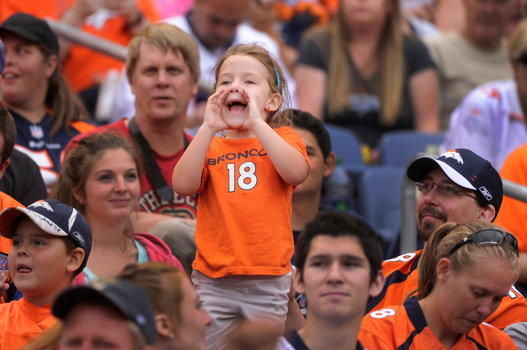 ". DENVER, CO. - AUGUST 03: ""Peyton Manning, I love you,\"" screamed Alyssa Knutson, age 5, from the stands Saturday. She attended practice with her father Mike. Denver Broncos fans waited inside Sports Authority Field Saturday night, August 3, 2013 hoping the weather would clear so that the team could practice.  Photo By Karl Gehring/The Denver Post"
