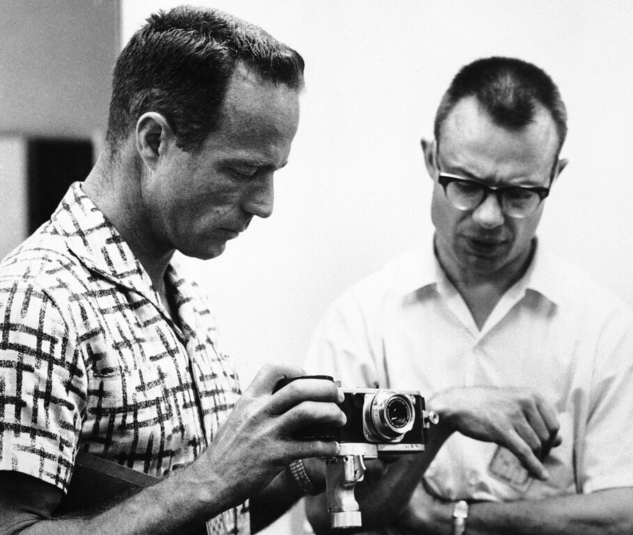 . Astronaut Scott Carpenter looks over the 35mm German made Robot camera he?ll hold in his hand to make pictures on his orbital flight scheduled for Thursday. With Carpenter, May 22, 1962 at his Cape Canaveral training quarters is Dr. Robert B. Voas, the astronauts\' training physician. (AP Photo)