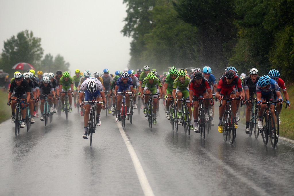 . The peloton ride through torrential rain during the nineteenth stage of the 2014 Tour de France, a 208km stage between Maubourguet Pays du Val d\'Adour and Bergerac, on July 25, 2014 in Bergerac, France.  (Photo by Bryn Lennon/Getty Images)