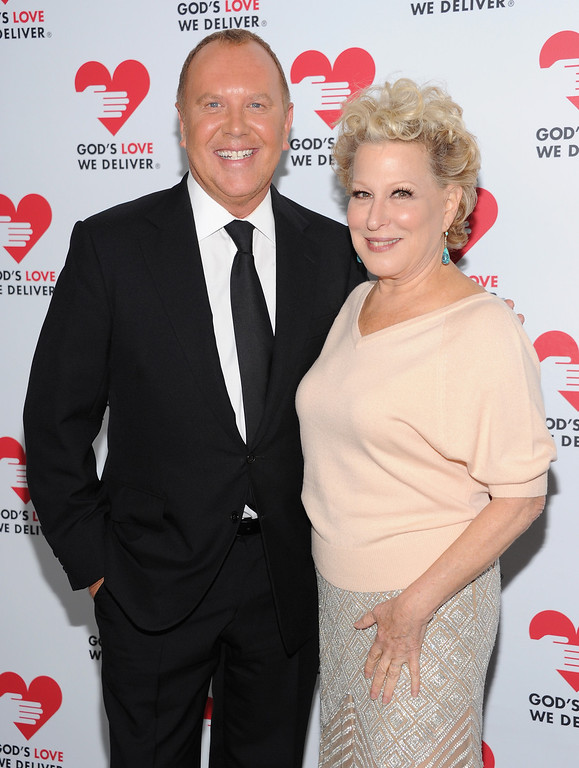 . NEW YORK, NY - OCTOBER 16:  Designer Michael Kors (L) and Actress Bette Midler attend God\'s Love We Deliver 2013 Golden Heart Awards Celebration at Spring Studios on October 16, 2013 in New York City.  (Photo by Dimitrios Kambouris/Getty Images for Michael Kors)