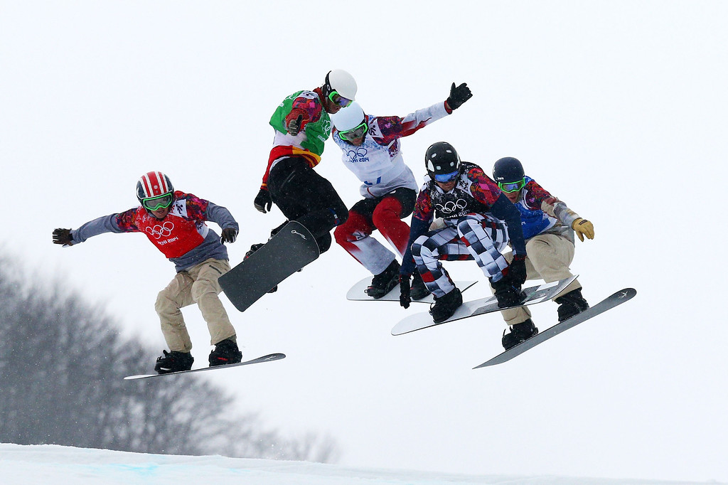 . Trevor Jacob of the United States (red bib), Lucas Eguibar of Spain (green bib), Kevin Hill of Canada (white bib), Nikolay Olyunin of Russia (black bib) and Alex Deibold of the United States (blue bib) compete in the Men\'s Snowboard Cross Semifinals on day eleven of the 2014 Winter Olympics at Rosa Khutor Extreme Park on February 18, 2014 in Sochi, Russia.  (Photo by Cameron Spencer/Getty Images)