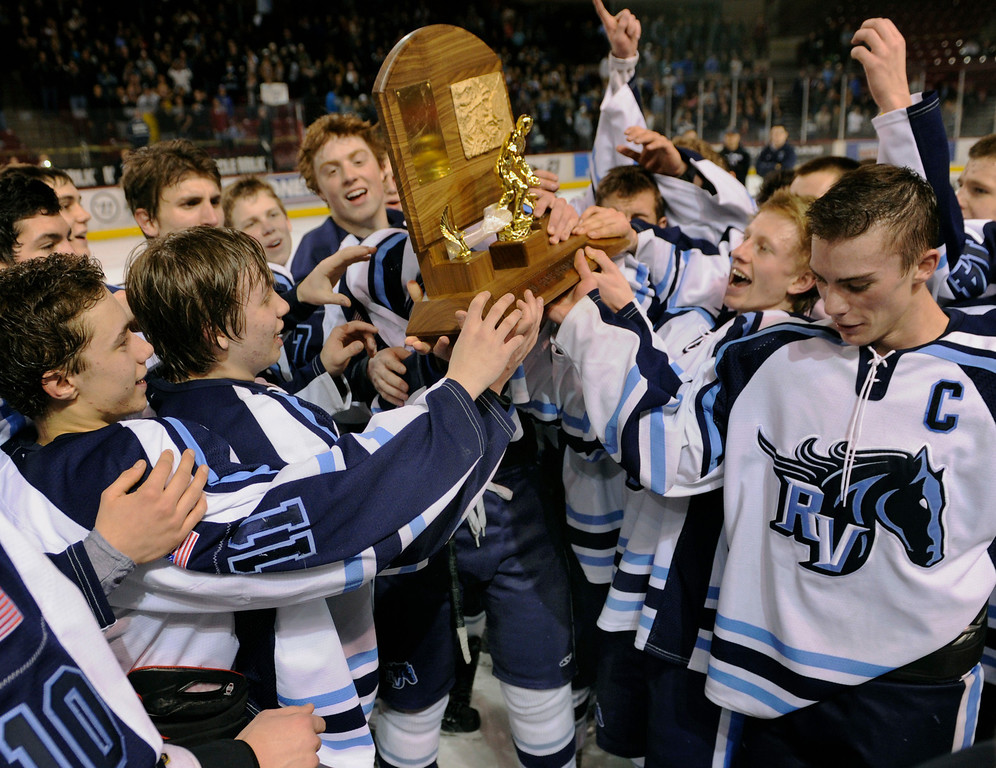 . DENVER, CO. - FEBRUARY 28: The Mustangs claimed the trophy Friday night. Ralston Valley High School beat Monarch 5-1 Friday night, March 1, 2013 to win the Colorado hockey championship at Magness Arena in Denver. (Photo By Karl Gehring/The Denver Post)
