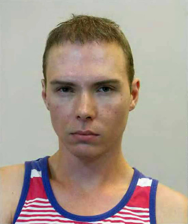 ". This handout picture released on June 5, 2012 by the Police in Montreal shows Luka Rocco Magnotta, a porn actor dubbed the ""Canadian Psycho\"" for allegedly killing and chopping up another man, after his detention in Berlin. Magnotta, 29, was arrested on June 4, 2012 at a Berlin Internet cafe on suspicion he murdered a 33-year-old Chinese student in Canada in May 2012 with an ice pick and hacked apart his body while filming the grisly killing.    AFP/GettyImages"