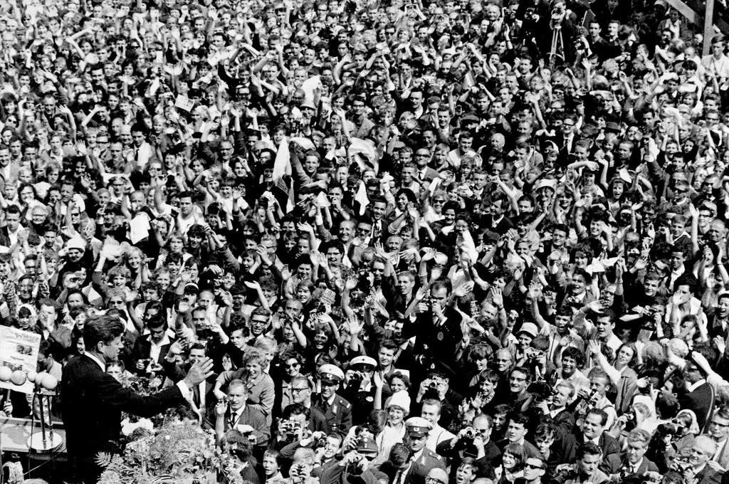 ". Kennedy, left, waves to a crowd of more than 300,000 gathered to hear his speech where he declared, ""Ich bin ein Berliner\"" (\""I am a Berliner\"") in the main square in front of Schoeneberg City Hall in West Berlin on June 26, 1963. Associated Press file"
