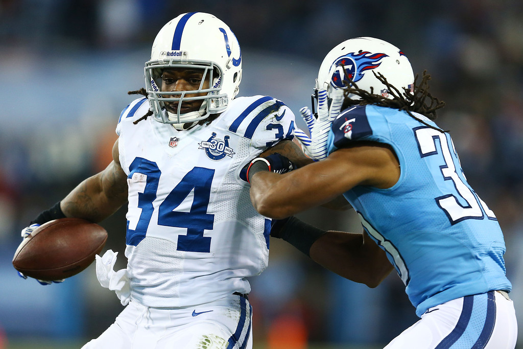. NASHVILLE, TN - NOVEMBER 14:  Trent Richardson #34 of the Indianapolis Colts carries the ball against the defense of  Michael Griffin #33 of the Tennessee Titans in the second quarter at LP Field on November 14, 2013 in Nashville, Tennessee.  (Photo by Andy Lyons/Getty Images)