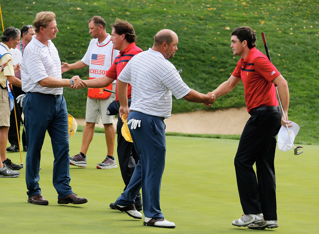 . DUBLIN, OH - OCTOBER 05:  Phil Mickelson and Keegan Bradley of the U.S. Team shake hands on the 17th green after defeating Ernie Els and Brandon de Jonge of the International Team 2&1 during the Day Three Four-ball Matches at the Muirfield Village Golf Club on October 5, 2013  in Dublin, Ohio.  (Photo by Gregory Shamus/Getty Images)