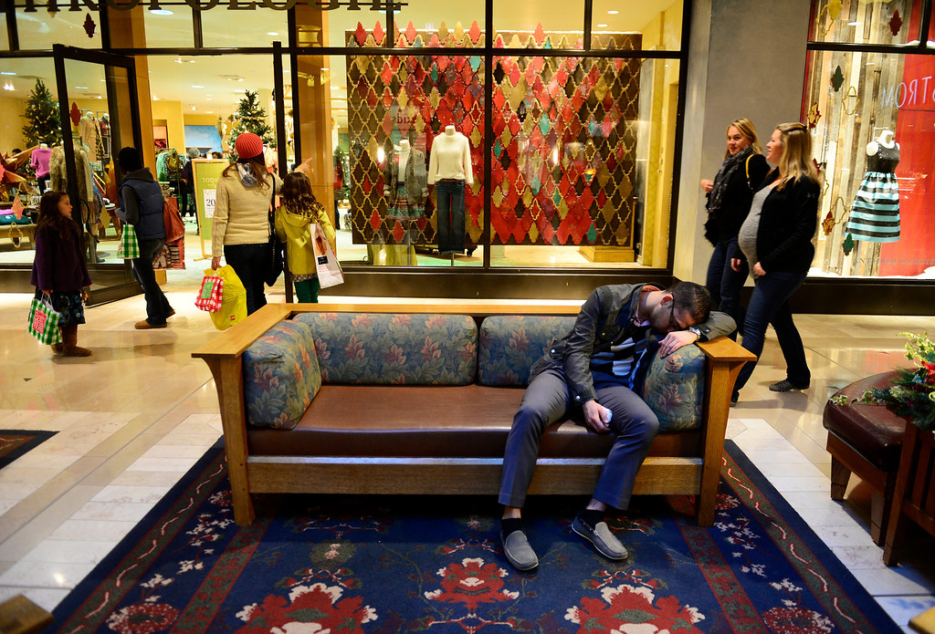 . The early start to Black Friday shopping takes its toll on a shopper at Park Meadows Mall in Centennial, November 29, 2013. With many stores opening on Thanksgiving crowds were lighter then normal for a Black Friday. (Photo by RJ Sangosti/The Denver Post)