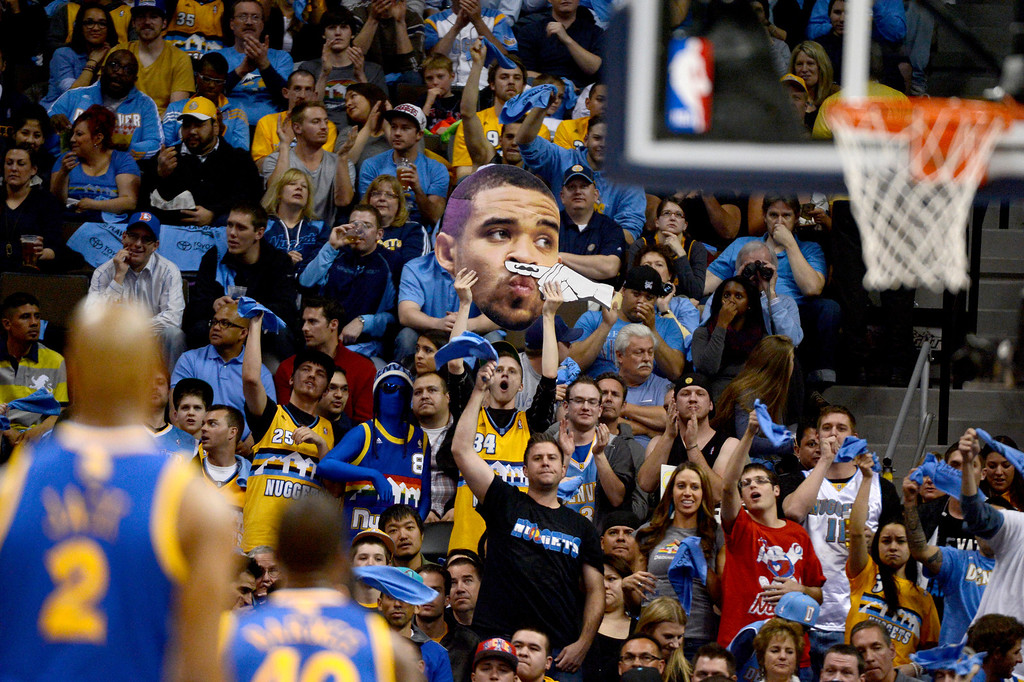 . DENVER, CO. - APRIL 23: Fans hold a cutout of Denver Nuggets center JaVale McGee (34). The Denver Nuggets took on the Golden State Warriors in Game 2 of the Western Conference First Round Series at the Pepsi Center in Denver, Colo. on April 23, 2013. (Photo by John Leyba/The Denver Post)