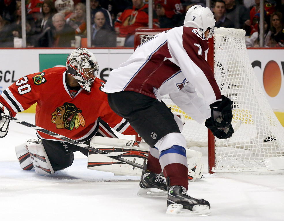 . Colorado Avalanche center John Mitchell (7) scores on Chicago Blackhawks goalie Ray Emery during the first period of an NHL hockey game, Wednesday, March 6, 2013, in Chicago. (AP Photo/Charles Rex Arbogast)