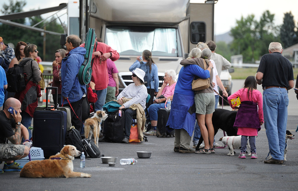 . BOULDER, CO - SEPTEMBER 13: Jamestown flood evacuees gather at a hanger at the Boulder Municipal Airport Friday afternoon, September 13, 2013 after being recused (Photo By Andy Cross/The Denver Post)