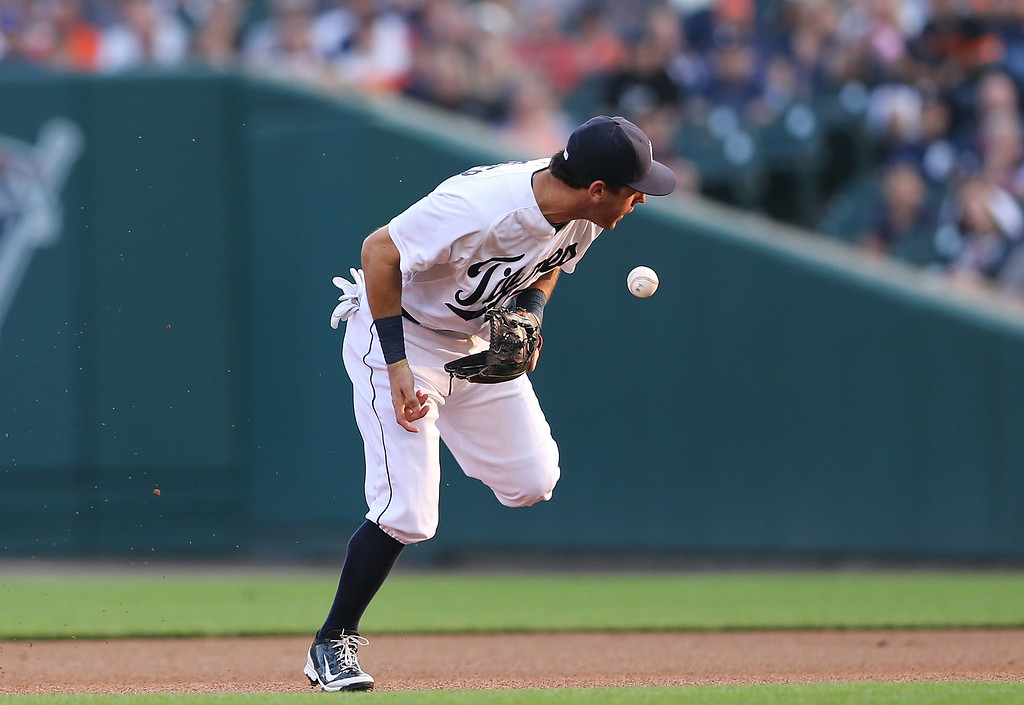 . DETROIT, MI - AUGUST 02: Second baseman Ian Kinsler #3 of the Detroit Tigers makes a fielding error during the first inning of the game against the Colorado Rockies at Comerica Park on August 2, 2014 in Detroit, Michigan.  (Photo by Leon Halip/Getty Images)