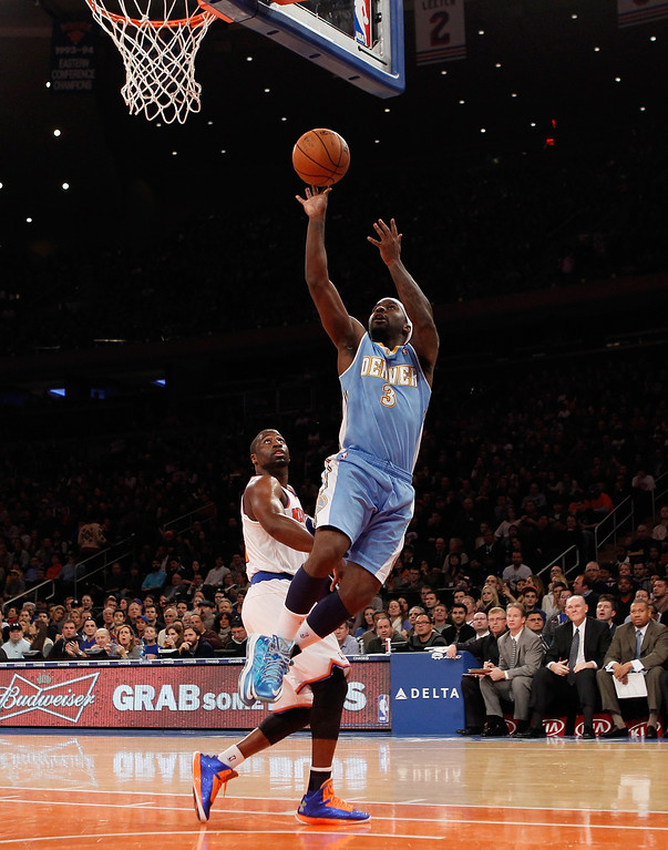 . Ty Lawson #3 of the Denver Nuggets goes up, misses two, and is fouled in the first quarter in the game against the New York Knicks at Madison Square Garden on December 9, 2012 in New York City.  (Photo by Bruce Bennett/Getty Images)