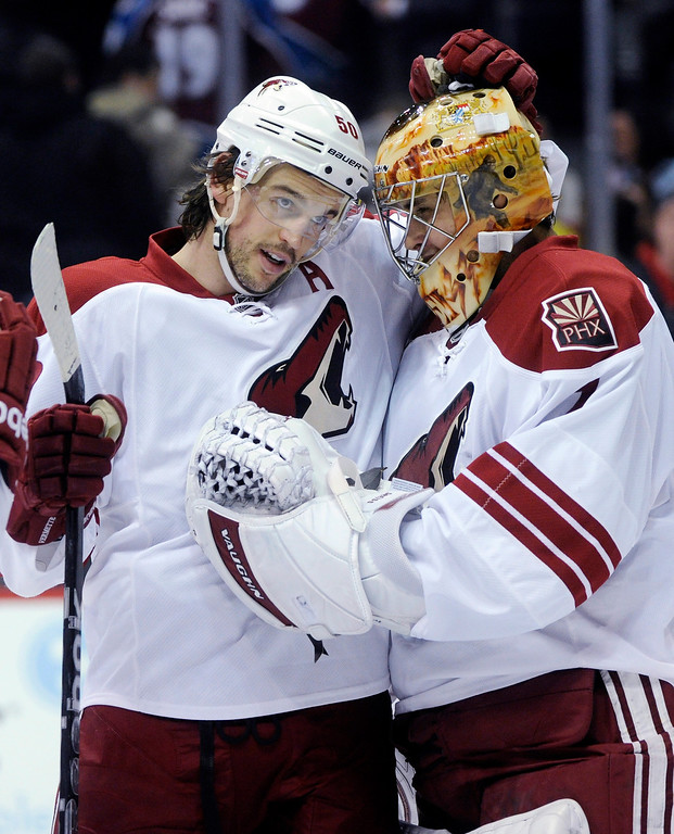 . Phoenix center Antoine Vermette (50) congratulated goalie Thomas Greiss (1) on the 3-1 victory over the Colorado Avalanche. Vermette had two goals in the second period.   Photo By Karl Gehring/The Denver Post