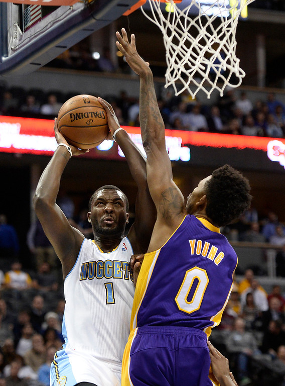. DENVER, CO - NOVEMBER 13: Los Angeles Lakers small forward Nick Young (0) attempts to block a shot by Denver Nuggets small forward Jordan Hamilton (1) during the first quarter November 13, 2013 at Pepsi Center. (Photo by John Leyba/The Denver Post)