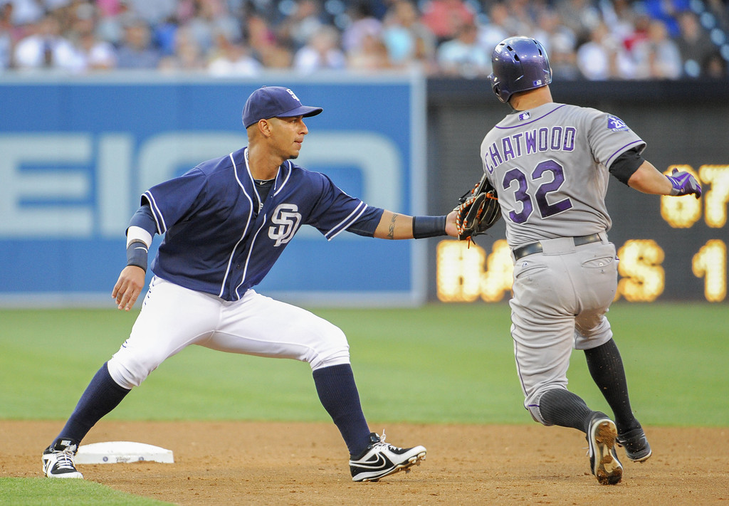 . SAN DIEGO, CA - SEPTEMBER 7:  Ronny Cedeno #3 of the San Diego Padres tags out Tyler Chatwood #32 of the Colorado Rockies out at second base during the third inning of a baseball game at Petco Park on September 7, 2013 in San Diego, California.  (Photo by Denis Poroy/Getty Images)