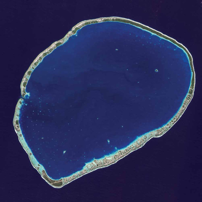 . Tikehau Atoll, French Polynesia A narrow ribbon of islets encircles a deep blue lagoon in French Polynesia. Tikehau Atoll is one of 78 coral atolls that make up the Tuamotu Archipelago, the largest chain of atolls in the world. Created over thousands of years by tiny, sea anemone�like coral polyps, atolls are some of the most complex and vibrant structures on the planet. In this 2009 EO-1 satellite image of the atoll, patches of coral make starlike spots across the turquoise expanse of the oval lagoon, 27 kilometers long and 19 kilometers wide. At the southernmost tip of the atoll, a large islet accommodates the village of Tuherahera and an airstrip. The whole atoll is surrounded by an almost continuous coral reef. There is a single pass on the western shore deep and wide enough for navigation in and out of the lagoon.   NASA