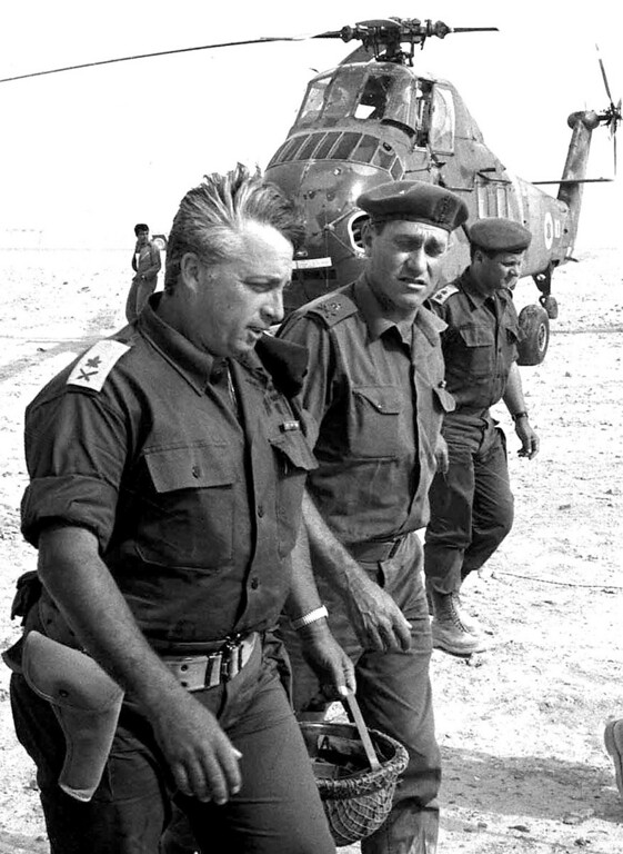 . A file picture dated 01 June 1967 shows Israeli Foreign Minister Ariel Sharon (L) in his military fatigues in the Negev desert prior the six-day Arab-Israeli war. AFP PHOTO/GPOGPO/AFP/Getty Images