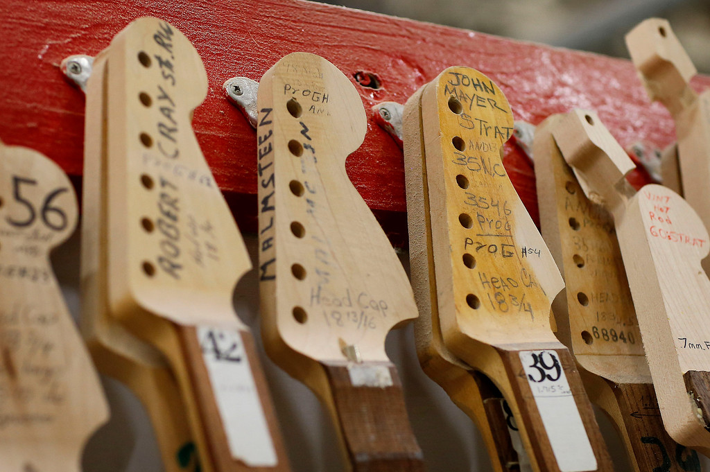 . The Fender Stratocaste neck templates of iconic guitarists Robert Cray, Yngwie Malmsteen and John Mayer hang in the Fender factory in Corona, Calif. on Monday, Oct. 14, 2013. The Fender Stratocaster, used by countless professional and amateur musicians, celebrates its 60th anniversary in 2014. (AP Photo/Matt York)