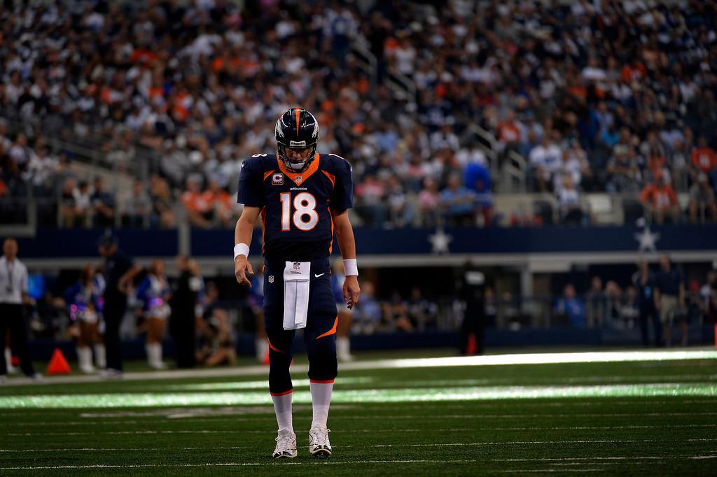 . ARLINGTON, TX. - October 06: quarterback Peyton Manning #18 of the Denver Broncos in the 3rd quarter vs the Dallas Cowboys in game 5 at AT&T Stadium October 06, 2013 Arlington, Texas. (Photo By Joe Amon/The Denver Post)