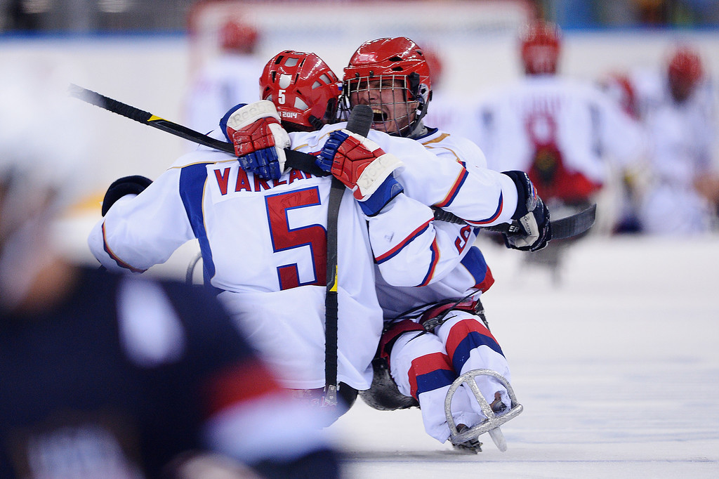 . Konstantin Shikhov of Russia celebrates with team mate Vasilii Varlakov after the Ice Sledge Hockey Preliminary Round Group B match between the United States of America and Russia during day four of Sochi 2014 Paralympic Winter Games at Shayba Arena on March 11, 2014 in Sochi, Russia.  (Photo by Dennis Grombkowski/Getty Images)