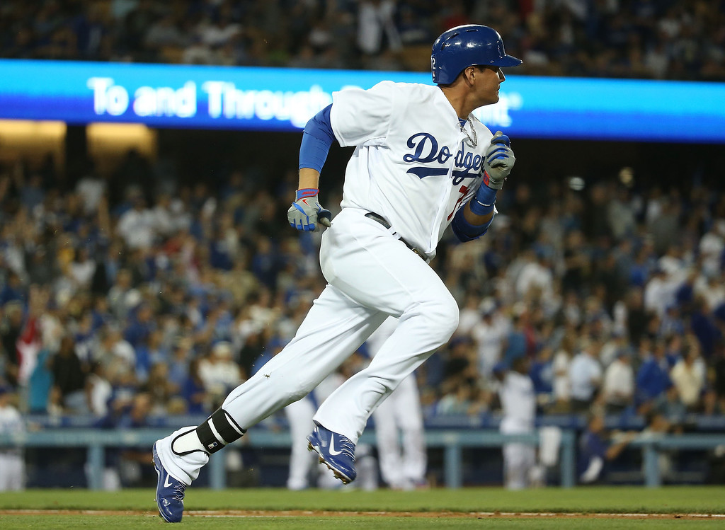 . Miguel Rojas #72 of the Los Angeles Dodgers runs to first base on a double to deep left field in the third inning during the MLB game against the Colorado Rockies at Dodger Stadium on June 18, 2014 in Los Angeles, California.  (Photo by Victor Decolongon/Getty Images)