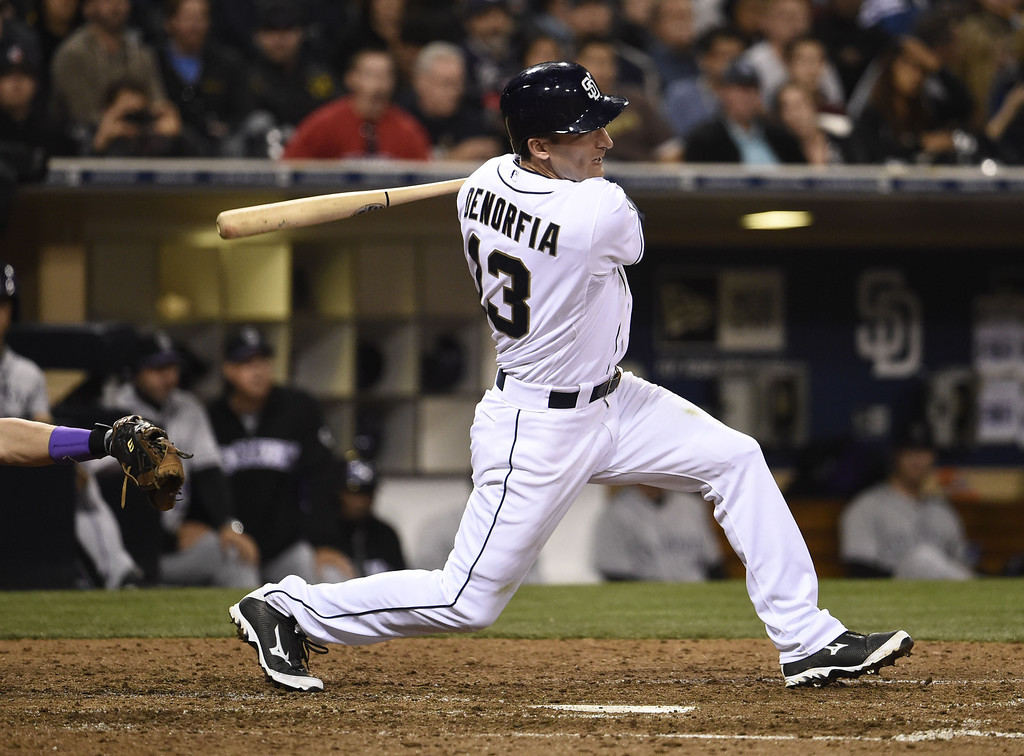 . SAN DIEGO, CA - APRIL 16:  Chris Denorfia #13 of the San Diego Padres hits an RBI double during the seventh inning of a  baseball game against the Colorado Rockies at Petco Park April 16, 2014 in San Diego, California.  (Photo by Denis Poroy/Getty Images)