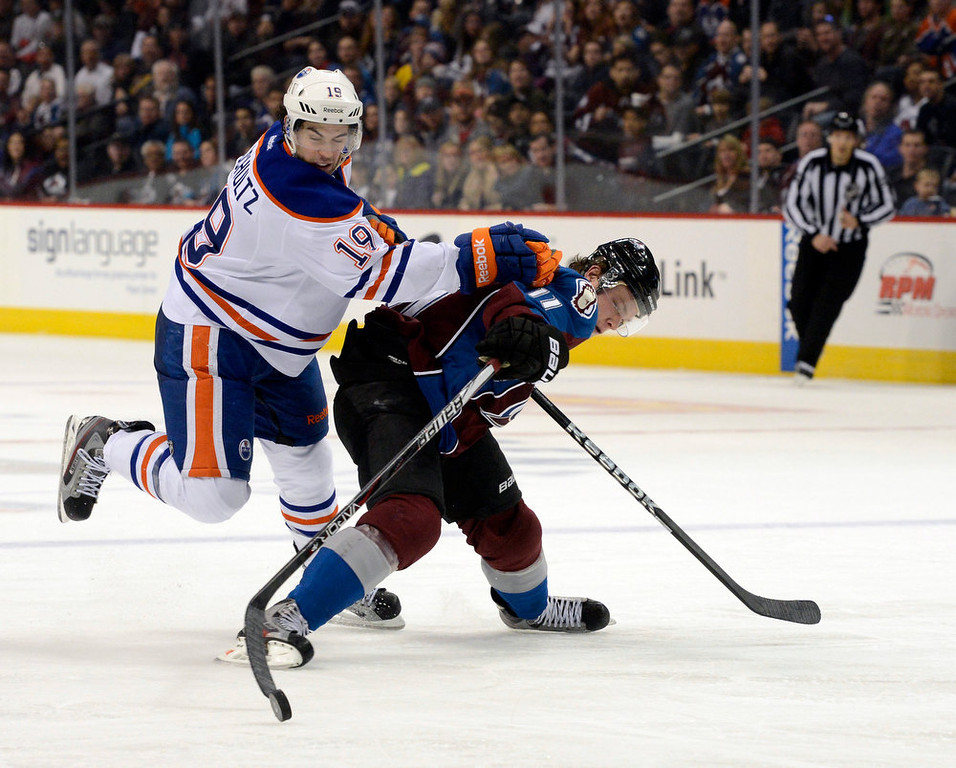 . DENVER, CO. - FEBRUARY 2ND: Jamie McGinn, right, Colorado Avalanche, and Justin Schultz, Edmonton Oilers, battle for control of the puck in the third period of play at the Pepsi Center in Denver Colorado, February 2nd, 2013.  (Photo By Andy Cross / The Denver Post)