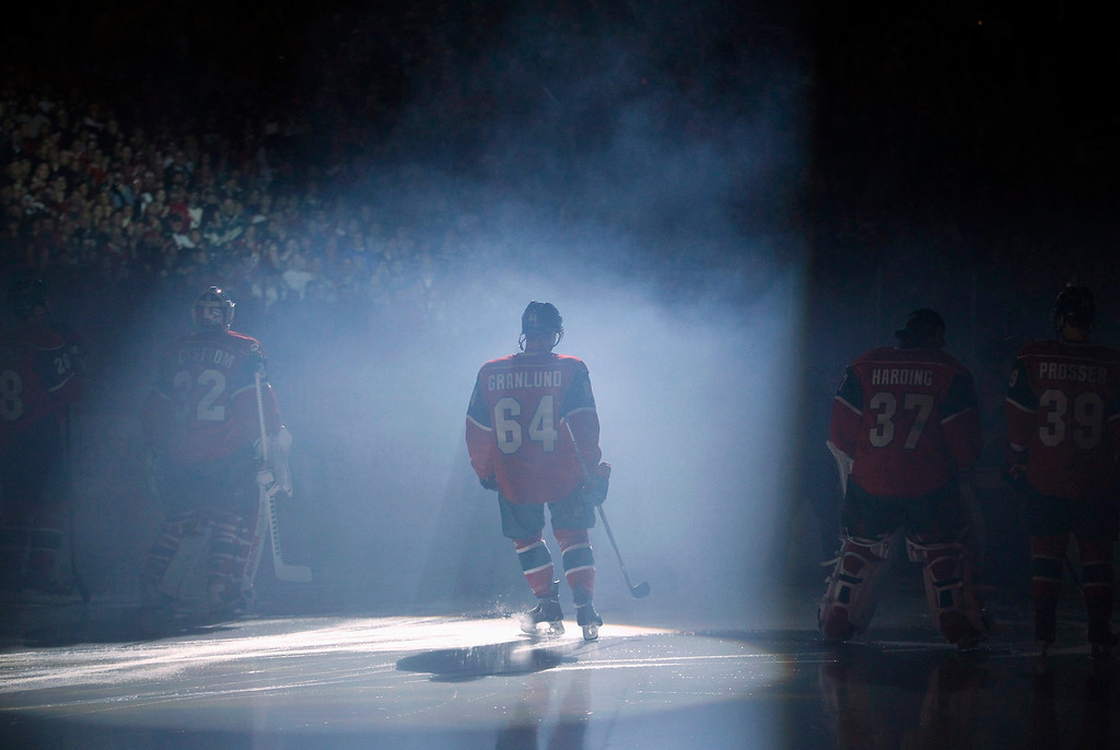 . Minnesota Wild center Mikael Granlund (64) skates to center ice during player introductions before the start of the Wild\'s NHL ice hockey game against the Colorado Avalanche in St. Paul, Minnesota, January 19, 2013. REUTERS/Eric Miller