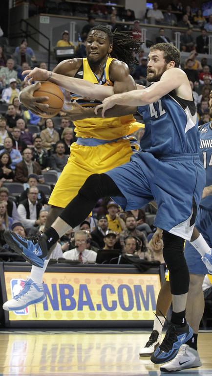 . Denver Nuggets forward Kenneth Faried ,left, and Minnesota Timberwolves forward Kevin Love (42) reach for a rebound during the first quarter of an NBA basketball game in Denver, Friday, Nov. 15, 2013. (AP Photo/Joe Mahoney)