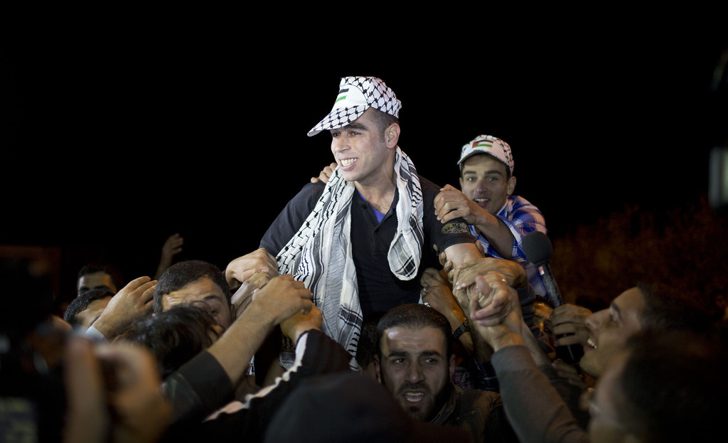. A released Palestinian prisoner reacts upon his arrival at the Erez crossing between Israel and the northern Gaza Strip October 30, 2013. Israel was preparing on October 29, 2013 to release 26 long-serving Palestinian prisoners, the second batch of 104 inmates who are to be freed in line with commitments to US-brokered peace talks. The release, due to take place late at night, will see 21 prisoners going to their homes in the West Bank. MAHMUD HAMS/AFP/Getty Images