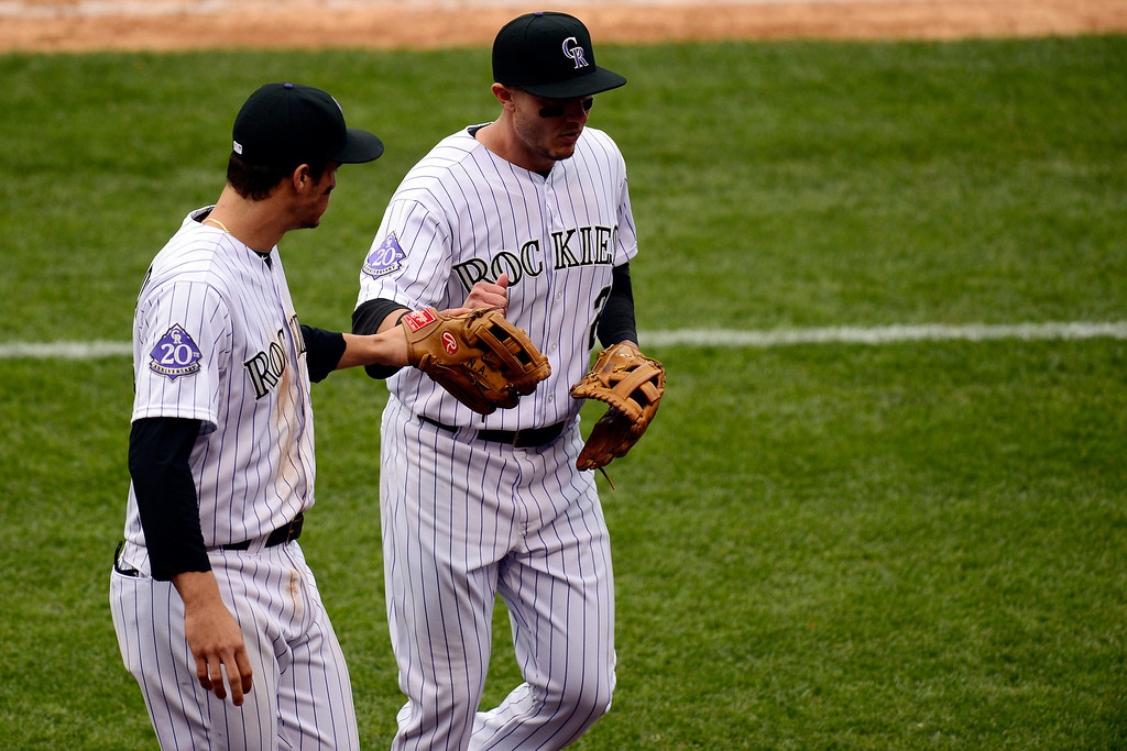 . DENVER, CO - MAY 5: Troy Tulowitzki (2) of the Colorado Rockies gets a fist bump from Nolan Arenado (28) after making an acrobatic throw to get Evan Longoria (3) of the Tampa Bay Rays out during the Rockies\' 8-3 loss.   (Photo by AAron Ontiveroz/The Denver Post)